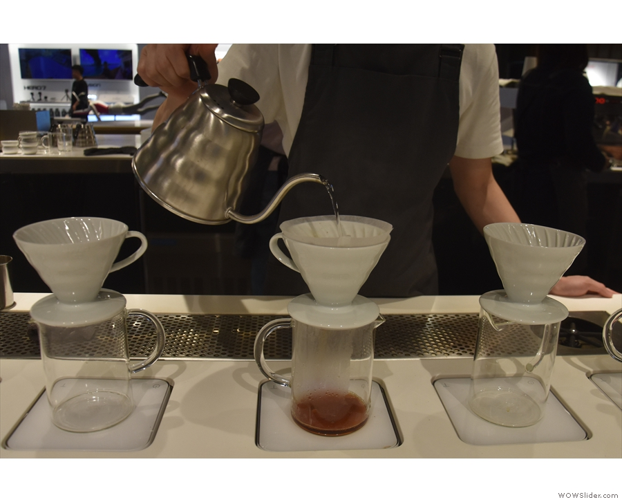 Water is slowly added to the V60 with a steady...