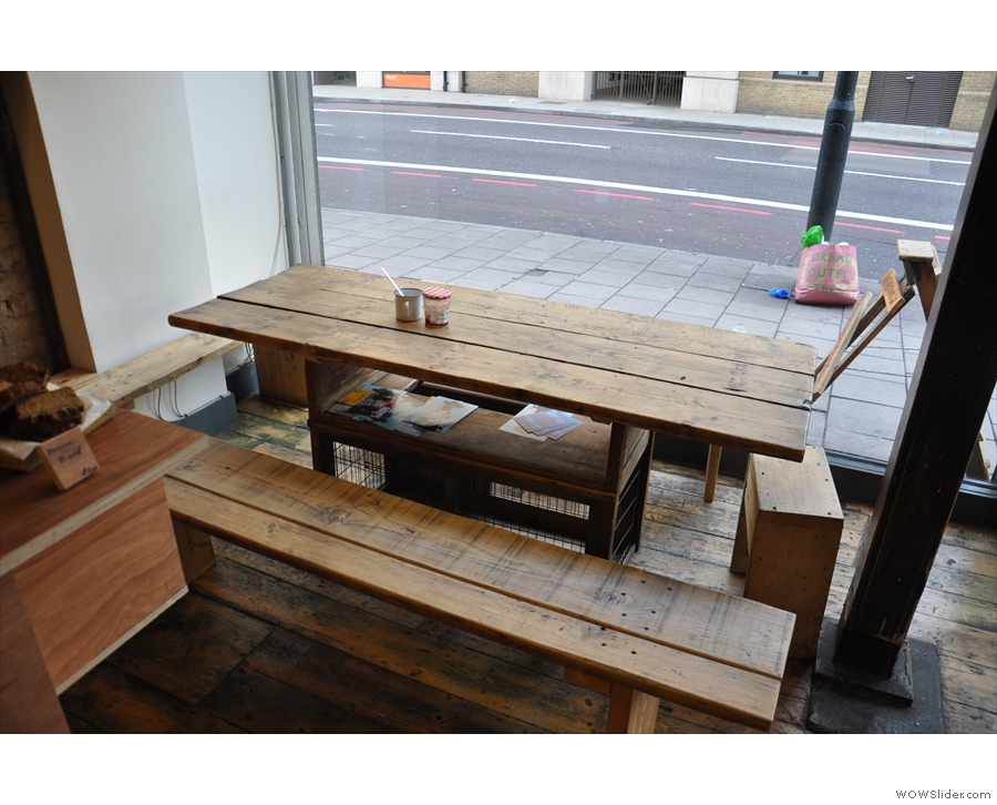 While this larger table is between window and counter.