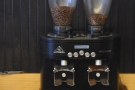 The twin Mahlkonig grinders house the Third Coast blend and the guest espresso...