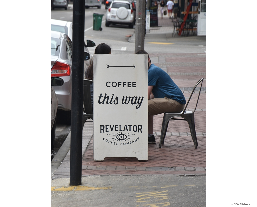 ... where the sign on the pavement hides one of the two tables.