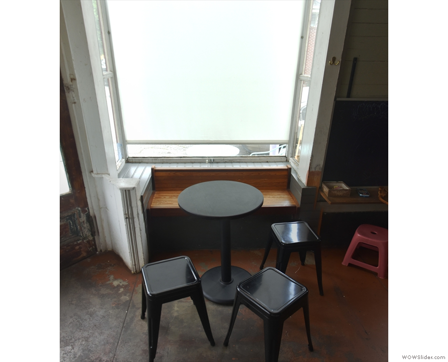 Each of the bay windows has its own table, stools and bench inset in the window.