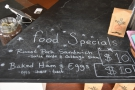 The weekend food specials are chalked on the counter-top.
