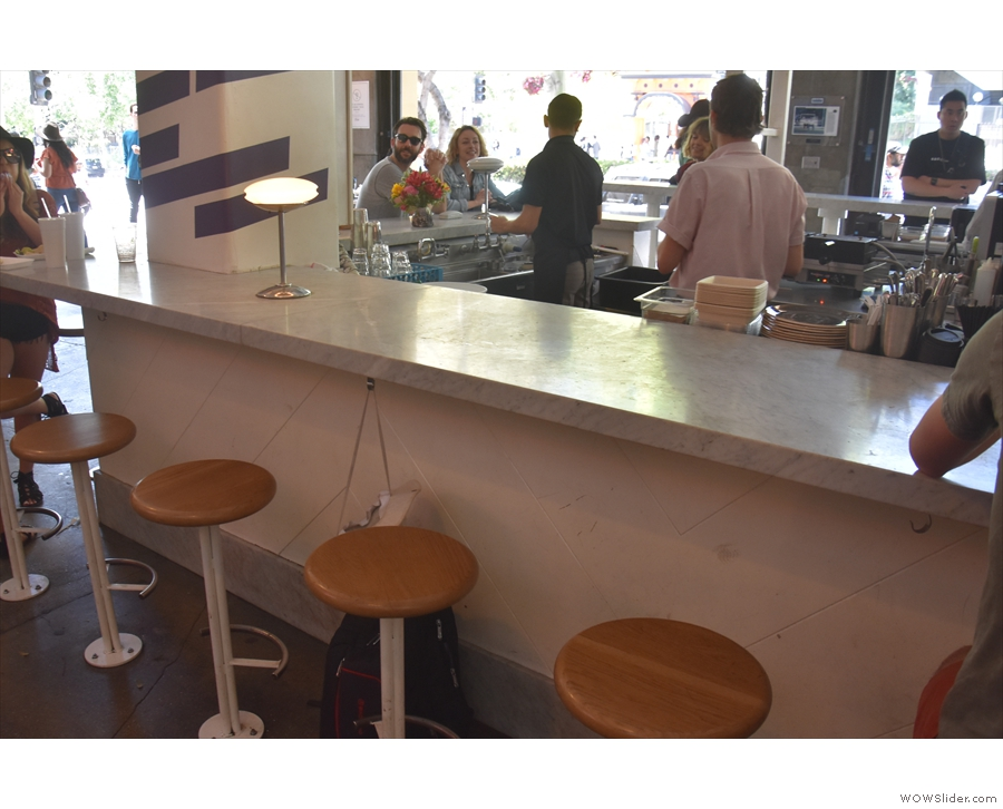There are twelve of these fixed stools in all, with handy hooks under the counter top.