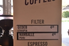 Meanwhile, the current coffee choices are posted up on the pillars.