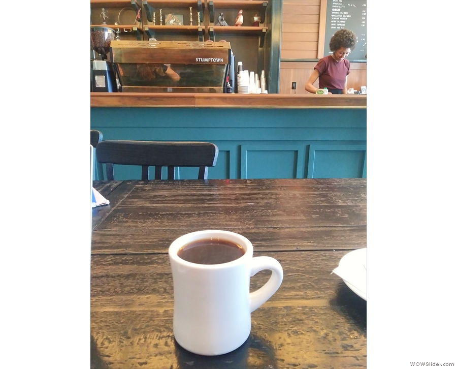 Here's my coffee, eyeing up the counter in the background.