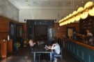 The only seating (in here) is a central communal table, with the counter on the right.