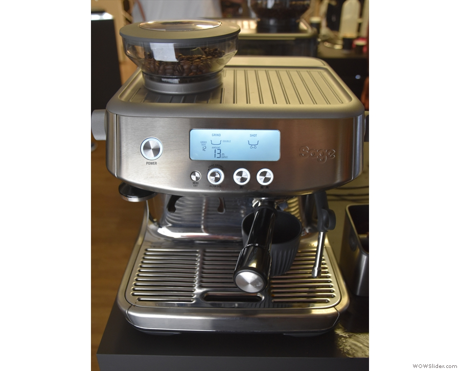 Coffee ground and tamped, attatch the portafilter to the group head on the right...