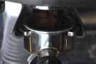 The performance is very similar, the in-built grinder giving excellent results.