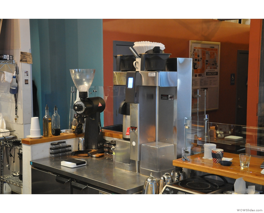 Batch brew, and the grinder for pour-over, are behind the till...