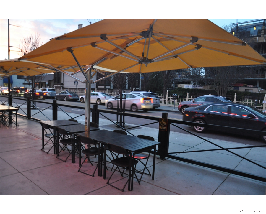 This row of tables lines the front, shaded by umbrellas, as seen here in 2015.