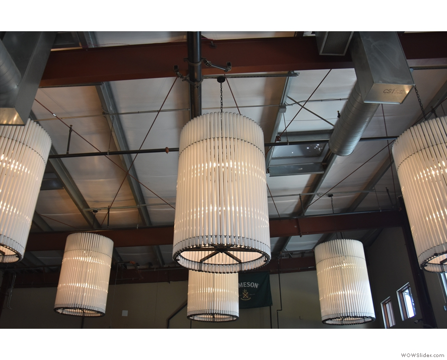 Meanwhile these vertical cylindrical bundles hang at the bar end of the communal space.