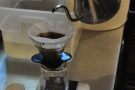 This lets the coffee bloom and, after 30 seconds, the main pour starts.