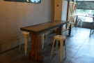 ... followed by a long table, more akin to a workbench, beyond the top of the ramp.