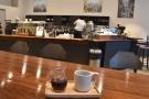 My coffee, a single-origin Kenyan Kungu Maitu Estate, casts its eye over the counter.