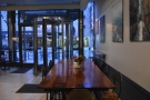Another view of the 10-person communal table, with the revolving door beyond...