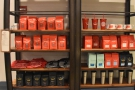 ... while the main shelves on the left are packed with bags of coffee.