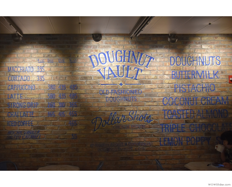 The menu is painted on the exposed brick of the left-hand wall.