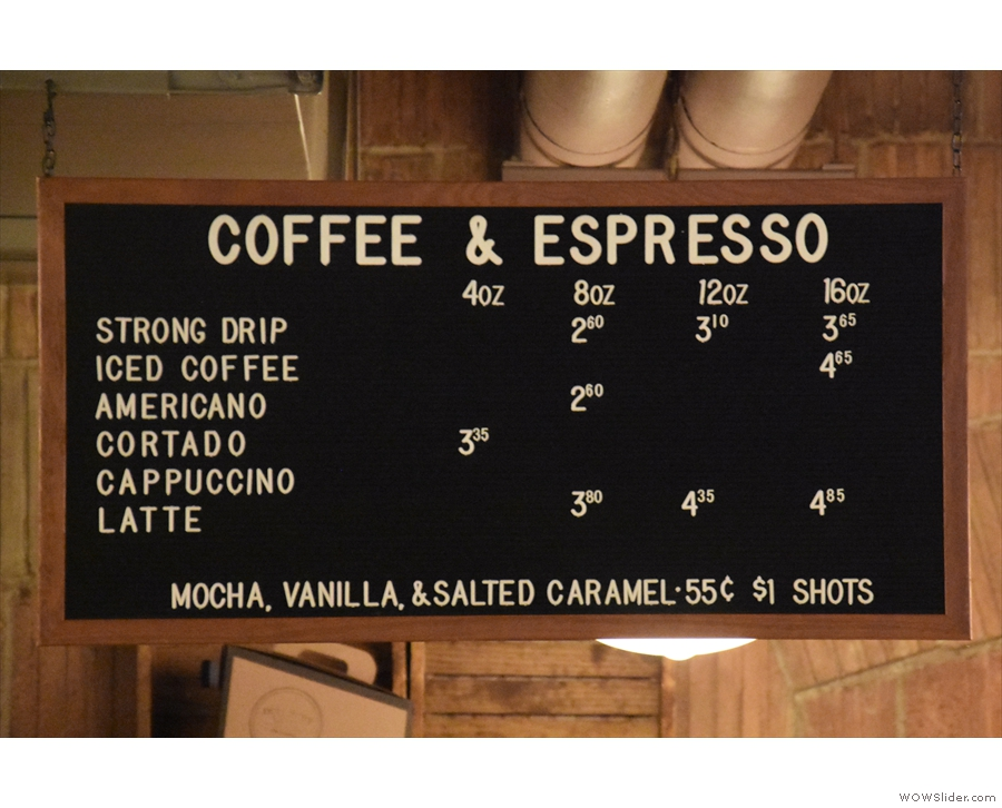 The drinks are repeated above the counter. Dollar shots refer to the price of the espresso!