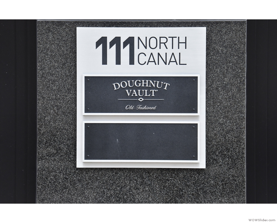 The first hint of what lies within: the name plate to the left of the door: Doughnut Vault!