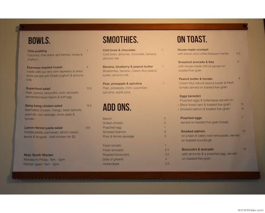 The food menu is on the wall behind the counter, brunch being served until three o'clock.