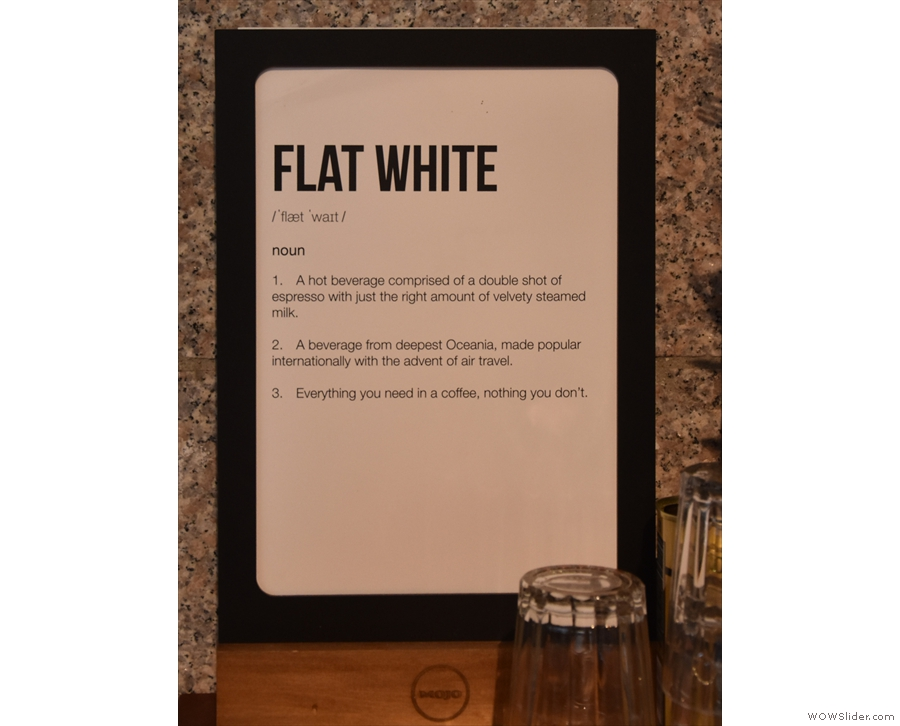 A handy sign explains a flat white to those not familiar with the Kiwi's signature drink...
