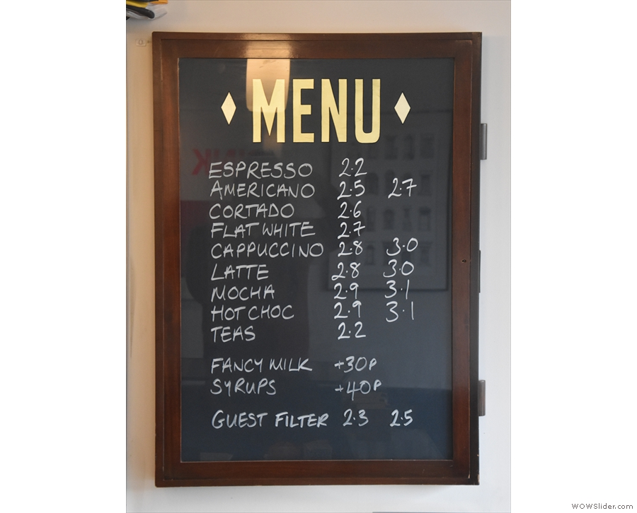 The menus are on the wall behind the counter, led by the concise drinks menu.
