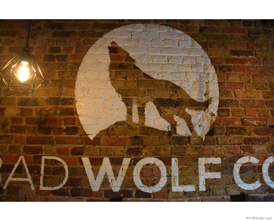 A closer look at the howling wolf logo.