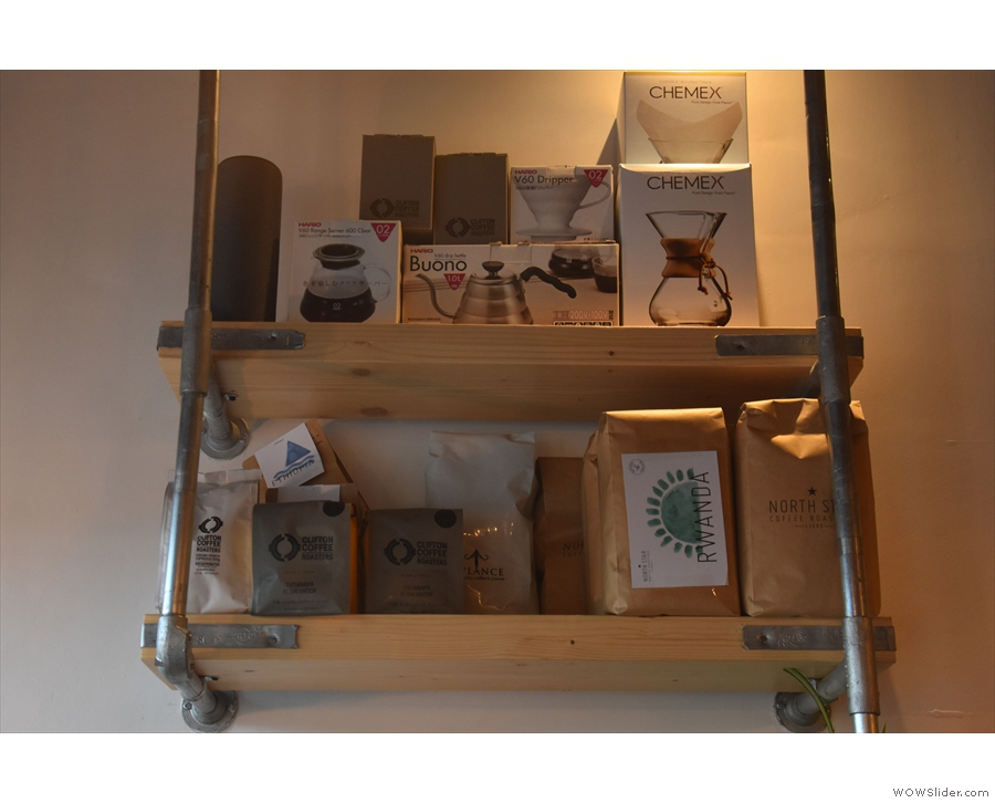 Another shelf has coffee supplies and various bits of coffee kit.