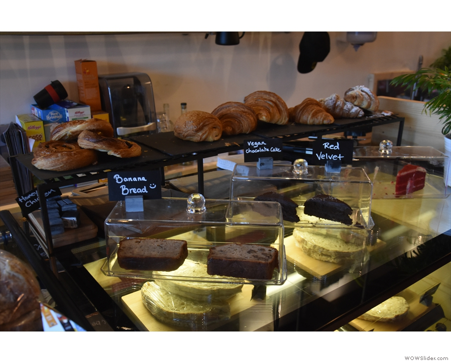 Back on the counter itself, and there's a selection of pastries and cakes to the right...