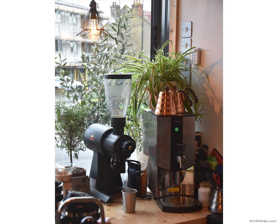 We've seen the brew bar, but here's the hot water boiler and EK43 grinder in the corner.