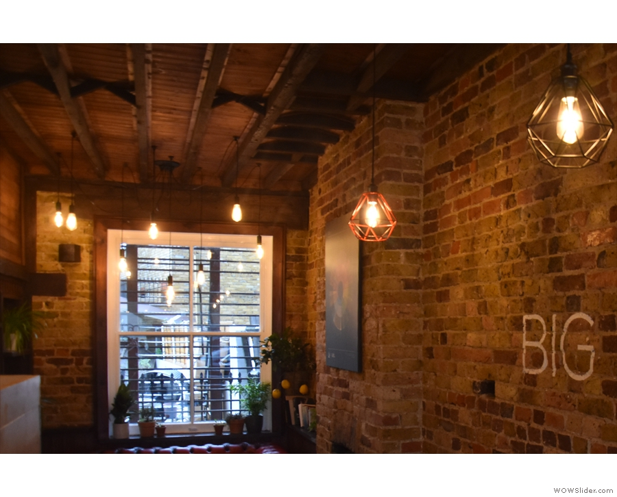 The decor is lovely, with plenty of wood and exposed brick, plus, despite the windows...