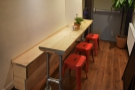There's more seating back here in the shape of this long, thin, six-person table.