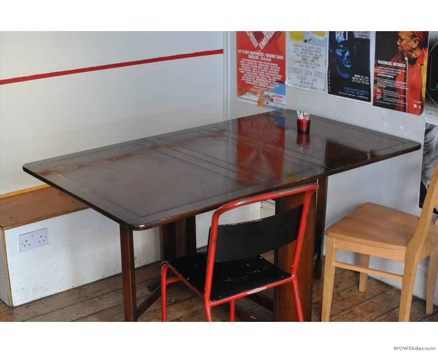 A more traditional table and chairs at the back.