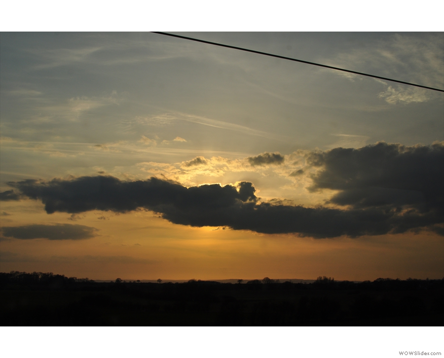 Although if you're being picky, the sun was disappearing behind the cloud rather than setting.