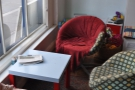 Two of the three comfy seats in the window of the main room