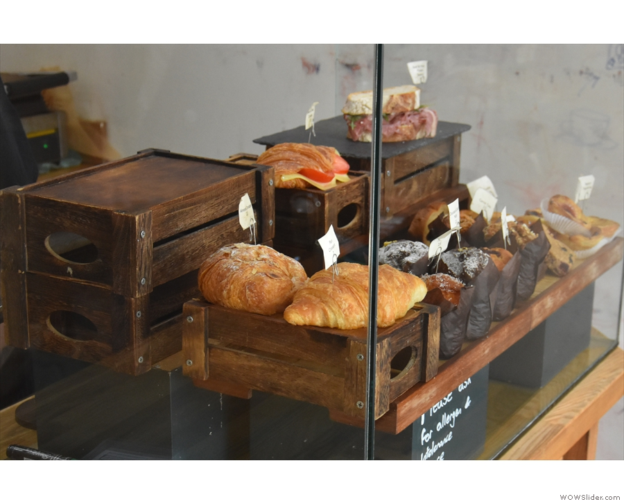Cakes and pastries, meanwhile, are in a glass display case at the front of the counter.