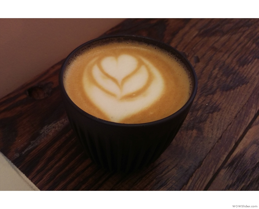 On my first visit, I had a flat white in my HuskeeCup.
