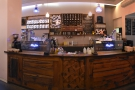 ... with its twin espresso machines. You collect your coffee here.