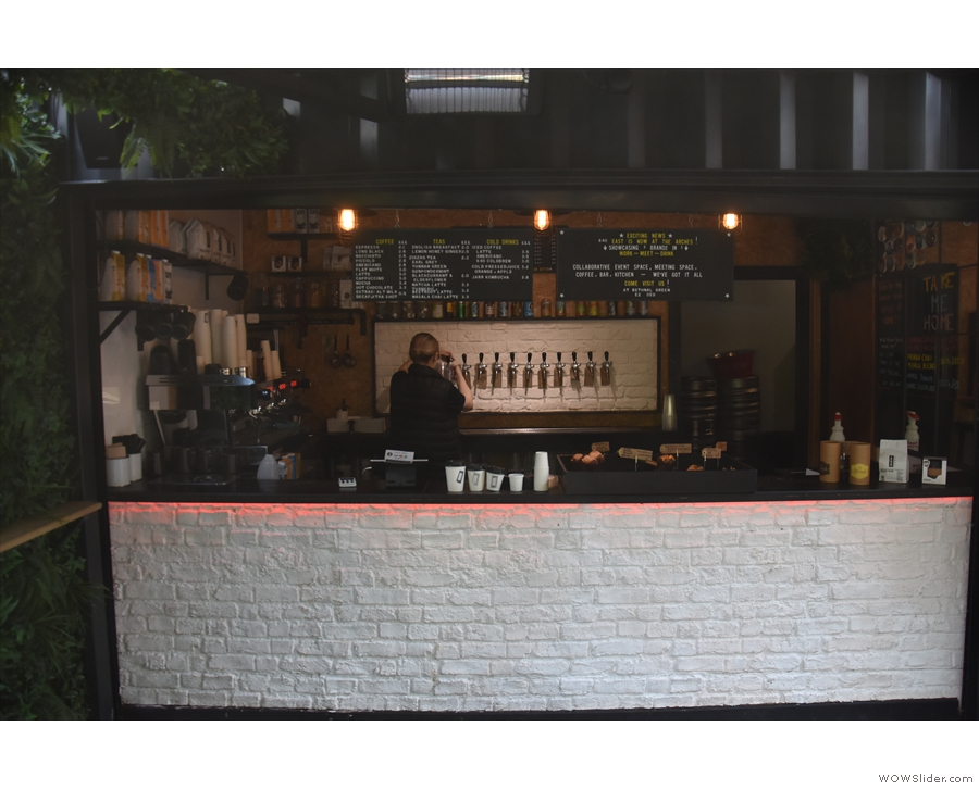 It mainly serves coffee, but there's a row of beer taps at the back and you can order wine.