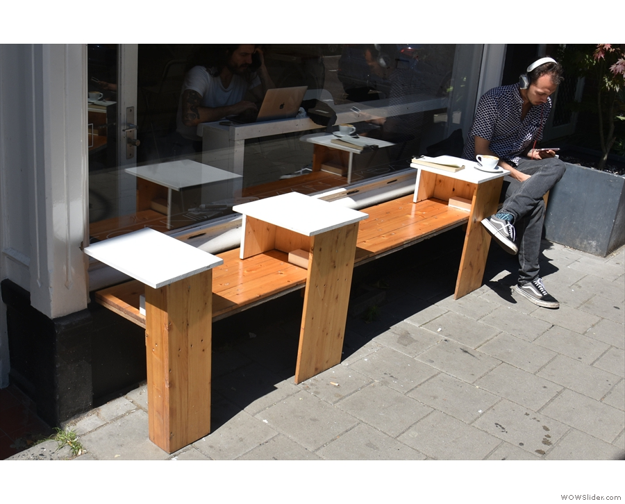There's a little bit of outside seating in the shape of this bench, with in-built tables.