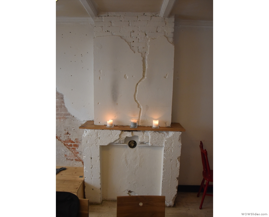 ... for example, while at the back, there's an old fireplace, which has been pressed into...