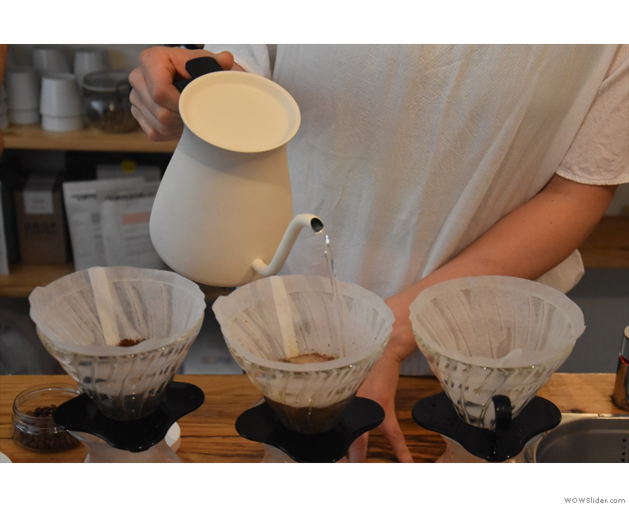 ... then off we go. Daniella is making three V60s at once. Each is filled in turn...