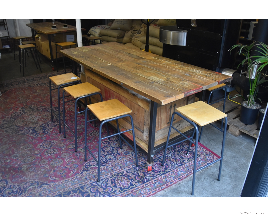 The seating on the right starts with this eight-person communal table...