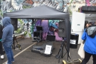 The buskers' stage had also been moved out here, with a gazebo protecting the...