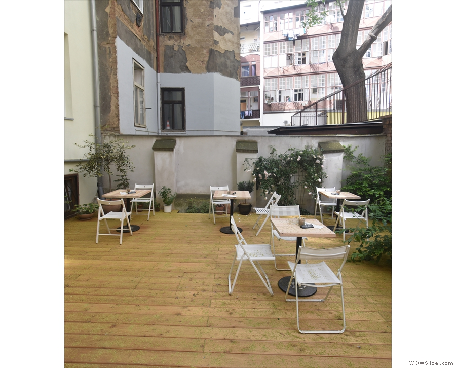 Another view of the tables on the decking on the left-hand side of the courtyard.