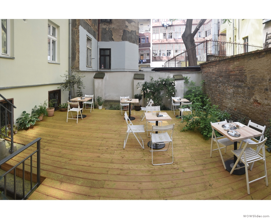 The tables and the decking on the left-hand side of the courtyard.