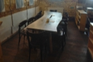 There's another room at the front, this time with a single, communal table.