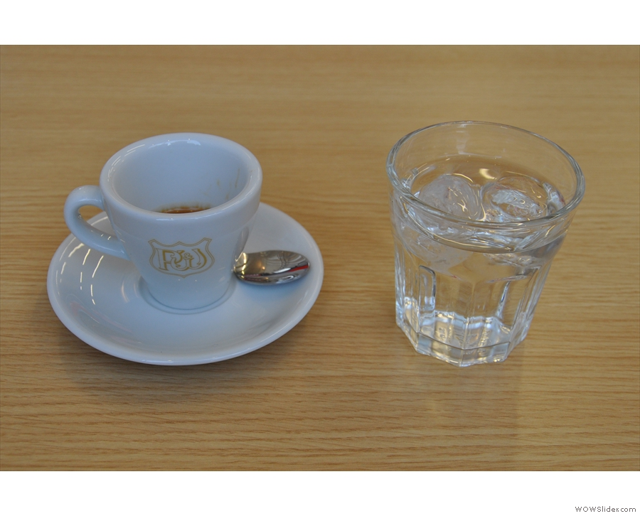 My espresso arrived in a Pumphrey's cup with a glass of water (without having to ask)