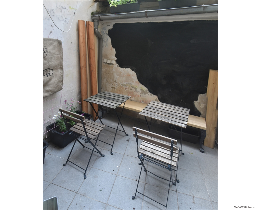 ... to this small, cosy courtyard, with just enough space for two tables and a bench.