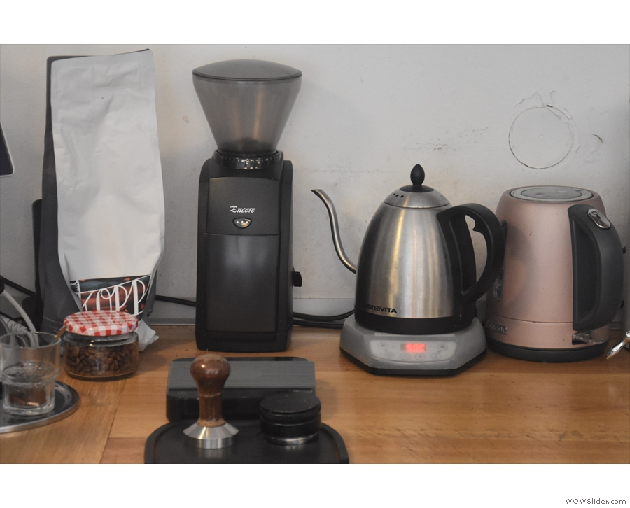 ... and on the back wall, the grinder and a kettle, plus that day's batch brew beans.